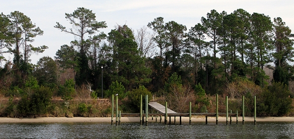 Waterfront lot for sale, including lamp post and dock. . .  this is called VERY hopeful development!
